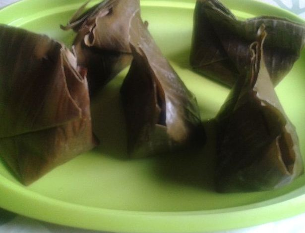 food wrapped with banana leaves