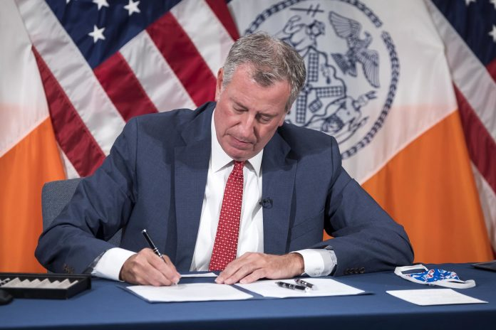 NYC Mayor Signing a Bill into Law